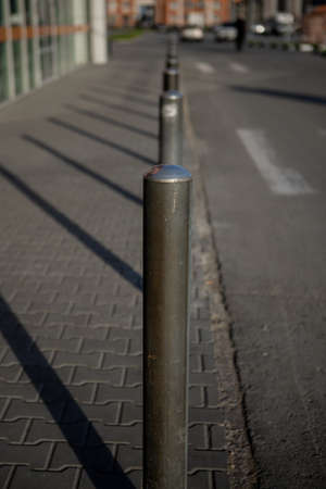 small iron posts along the road