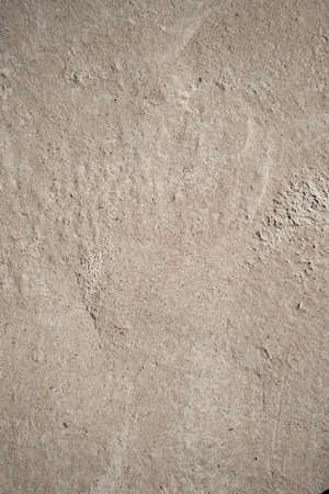 Space for text. Concrete light brown background. Abstract urban texture.