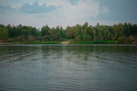 Omsk. Siberian expanses. Beauty Of Russia. irtysh river. There are trees along the river Bank. The surface of the water. View from the shore.