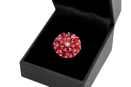 spinel: Red gemstone ring in a black velvet giftbox, isolated over white. Stock Photo