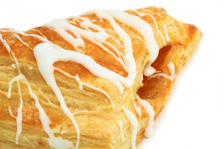 Close up view of an apple pastry, isolated over white. Stock Photo