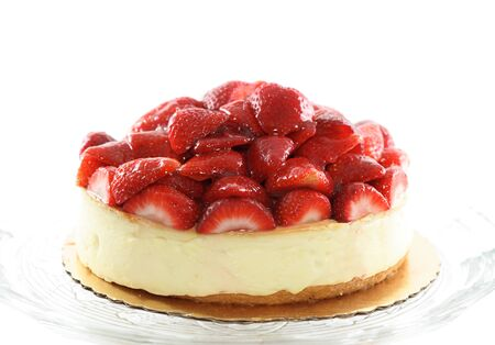Strawberry cheesecake isolated over white.