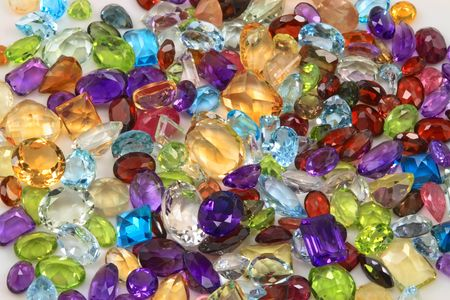 Mixed variety of natural gemstones, including precious and semiprecious gems. photo