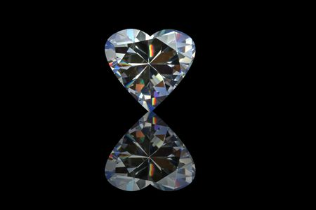 Diamond Heart with reflection, isolated on a black background.