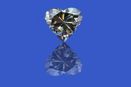 Heart shaped diamond with reflection, isolated on a blue background.