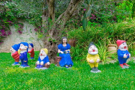 seven dwarfs: The Snow White statues and the seven dwarfs in a garden Editorial