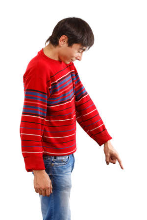 Man in red pullover showing down isolated on white background photo