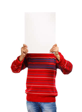 Man in red pullover shows presentation hiding his face isolated on white background photo