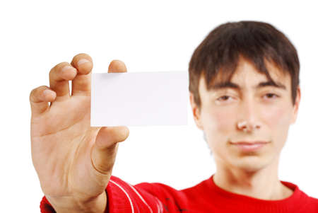 Portrait of man in red sweater isolated on white background holding little business card photo