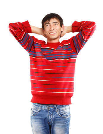 Young man in red sweater smiles standing on white background photo