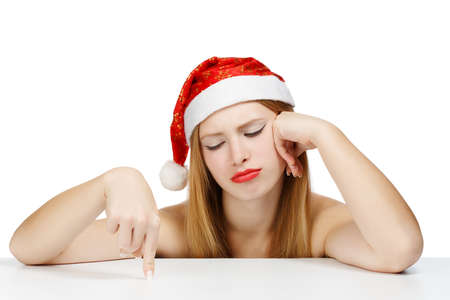 wearied: Young woman in santa claus hat posing isolated on white background with wearied look