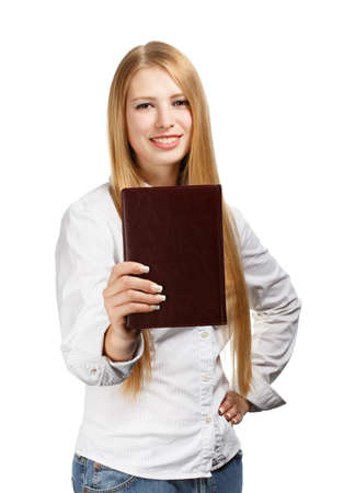 Young woman in business style standing with brown personal organizer isolated on white background photo