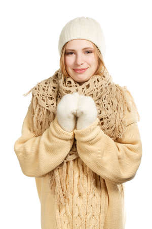 Young smiling woman in warm winter clothing standing isolated on white background photo