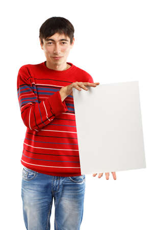 Man in red striped sweater stands on white background holding big advertisement card photo