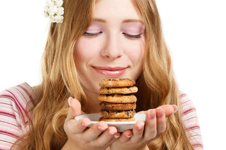 Beautiful young smiling woman with cookies isolated on white background photo