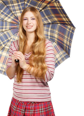 Beautiful young smiling woman with chequered umbrella isolated on white background photo