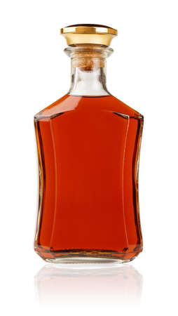 Stylish cognac bottle standing isolated on white background photo