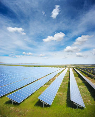 Solar panels with green field Stock Photo