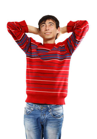 unworried: Young man in red sweater smiles standing on white background