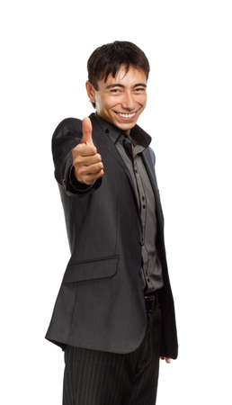 dignified: Young businessman in dark grey coat and steel-blue shirt standing isolated on white background with thumbs up