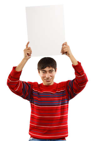 Smiling man in red striped sweater on white background with big business card holding in raised hands photo
