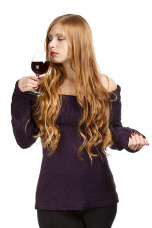 Young beautiful woman with expressive hairstyle and closed eyes holding glass of red wine isolated on white background