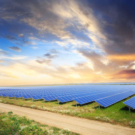 Solar panels with sunsets sky and road Stock Photo