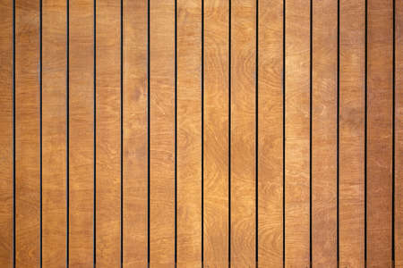 Abstract brown striped wall background of rectangular vertical wooden panels with spots and stains of wood structure, Copyspace.