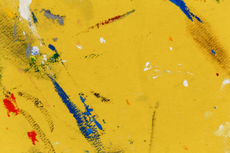 Grunge abstract background on canvas painted with yellow paint and colorful random strokes. Shallow dof. Copyspace. Stock Photo