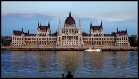Parlament: Hungarian parlament with a boat and a photographer