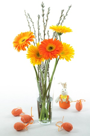 A nice, yellow and orange coloured easter bouquet with catkin, easter eggs and rabbit  photo