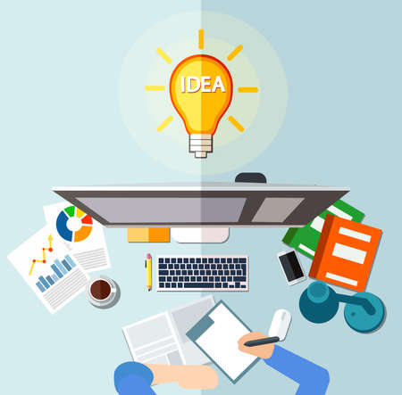 Workplace and idea light bulb concept. Businessman sitting at desk in front of desktop, signing documents.
