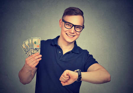 Cheerful content young man making easy money in short space of time looking at camera. 写真素材