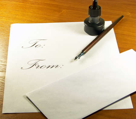 old envelope: Calligraphy set with pen and ink and letter and envelope. Stock Photo