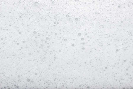 White foam from soap over white background