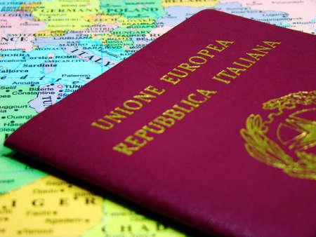 Photo of an Italian passport against map of Europe. Stock Photo