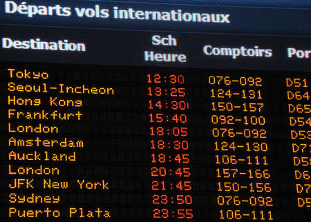 Canadian airport information board, international departures, French. Editorial