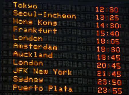 Canadian airport information board, international departures.