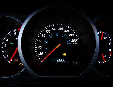 kilometer: Close up of car dashboard gauges.