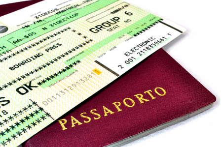 Italian passport and air travel boarding pass.