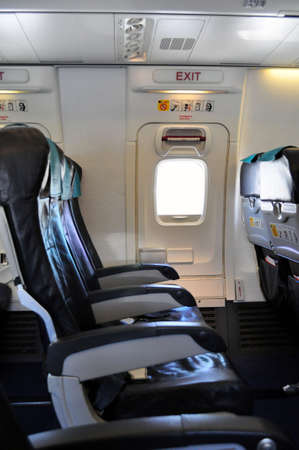 emergency exit: Emergency exit row. Passenger cabin of a commercial airliner.