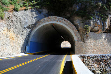 road tunnel: Mountain road passing through a tunnel in the island of