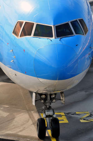 Air transportation: Close-up of a passenger airliner approaching the gate. Stock Photo