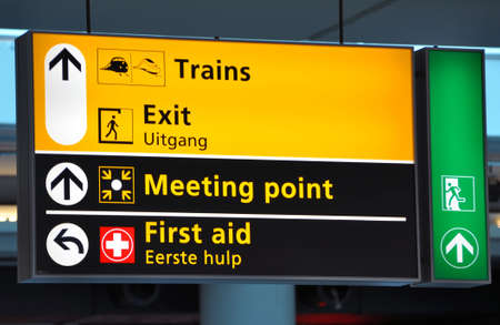railway points: Terminal sign: train station at Amsterdam Schiphol International.