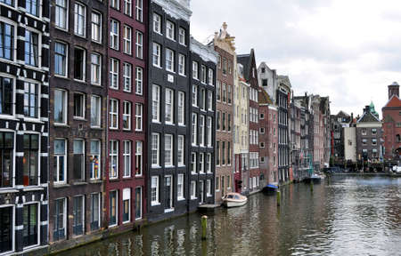 typical: Typical buildings facing a canal in Amsterdam.