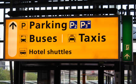 Amsterdam Schiphol terminal sign: bus, taxi and parking