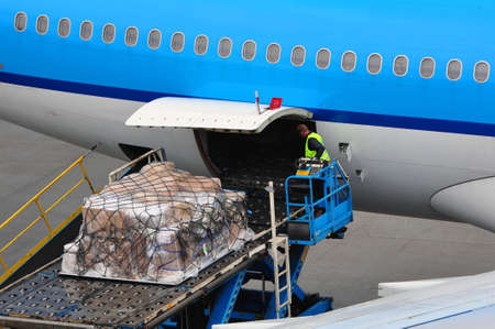 freight: Air transportation: airplane loading cargo