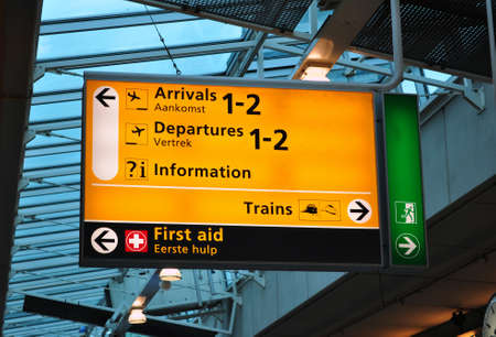 Airport sign: arrival, departures, first aid. Amsterdam Schiphol.
