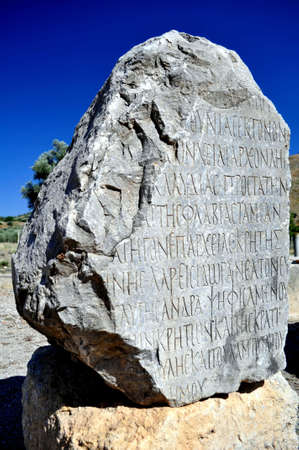 Ancient Greek writing on stone. Archaeological site of Gortyn, Crete, Greece.