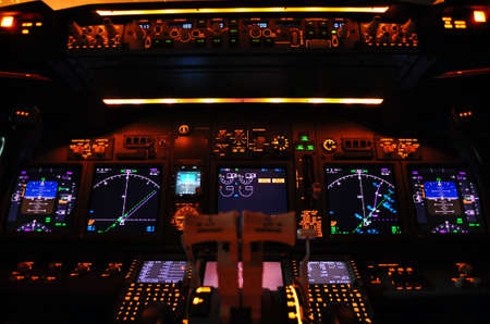 panel: Instrument panel of a modern airliner at night (Boeing 737-800 Next Generation). Stock Photo